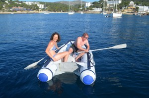 Roger rowing the dinghy