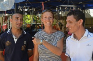 Salim, our policeman, Susie and Hakim, our guide with the present they kindly bought Susie