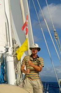 James hoists the French Polynesia courtesy flag and Q flag
