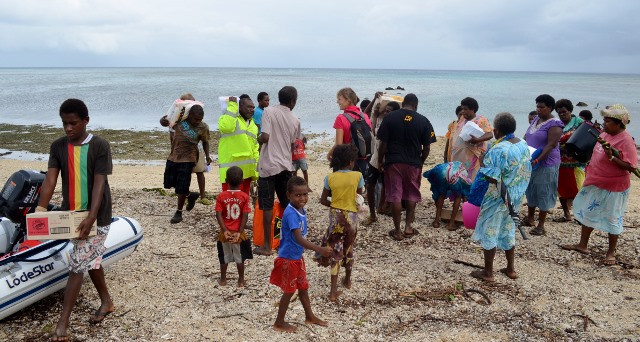 Villagers on the beach to help carry
