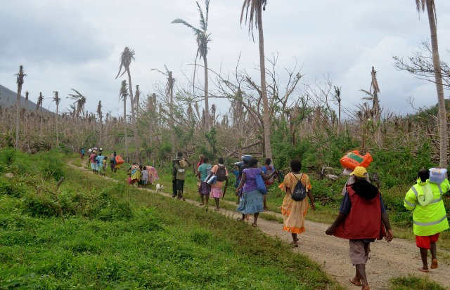 Walking to the village - not much left of the coconut trees