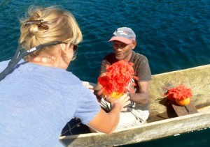 Jonny Ruka welcomes Adina with drinking coconuts decorated with hibiscus flowers