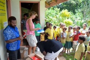 Susie helping handing out books and pens