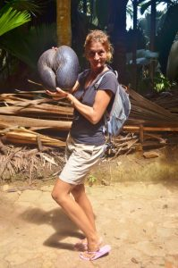 Susie holds up a coco de mer nut...